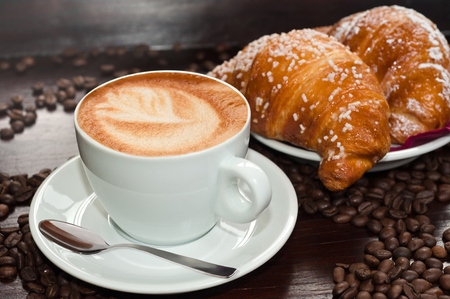 cappuccino with Brioches and coffee beans 스톡 콘텐츠