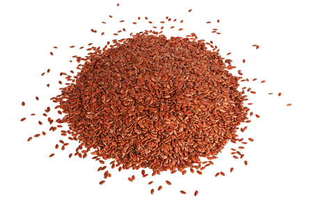 Brown flaxseeds pile isolated on white background