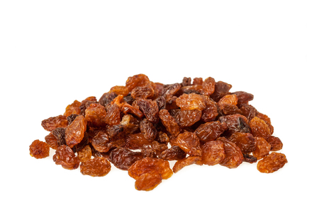Sultana raisins heap isolated on white background