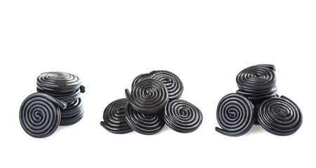 licorice wheels isolated on white Stockfoto