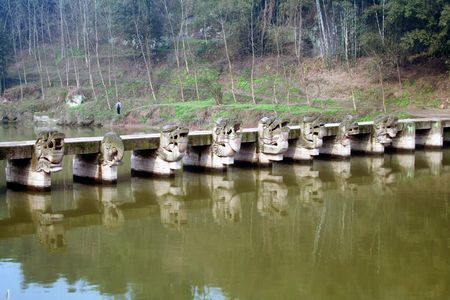 pontine: Pontine Liuzhou is located in Luding County, Sichuan Province, was built in AD 1378 - 1398. Bridge 5 meters high, 54 meters long, 1.9 meters wide, pier followed by carving of dragons, lions, elephants, unicorn mascot. Stock Photo