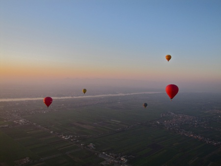 Hot air balloons over the Nile at sunrise photo