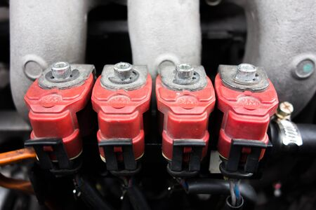 l p g: Inyectores de GLP rojas Foto de archivo