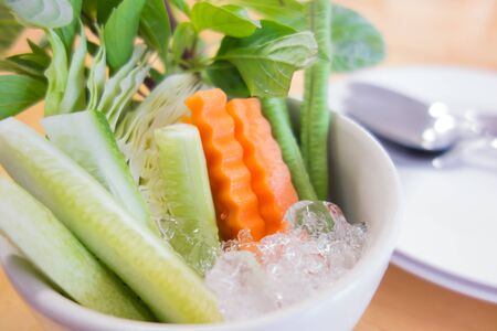 cow pea: Cucumber carrots and cow pea on ice