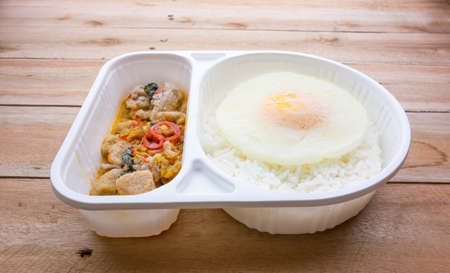 freeze: Freeze of basil Fried Chicken and fried egg convenience food Stock Photo