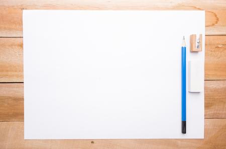 paper sheets: Blank paper on the wood table with pencil eraser and sharpener