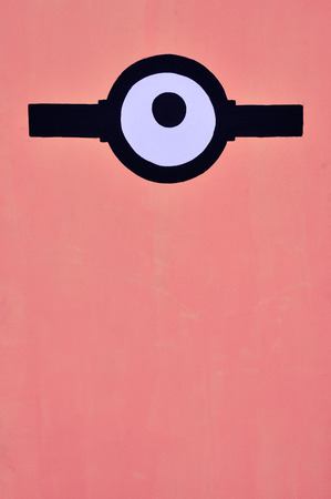 one eye: Coral color background with one eye