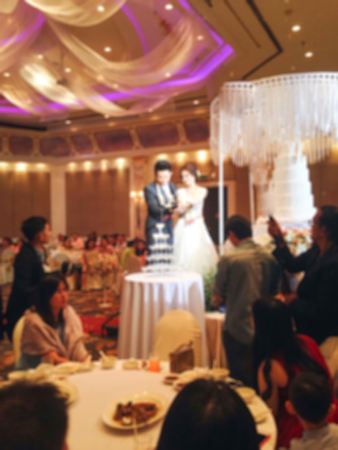 asian bride: Blur Asian bride and groom in wedding celebration in the grand ball room