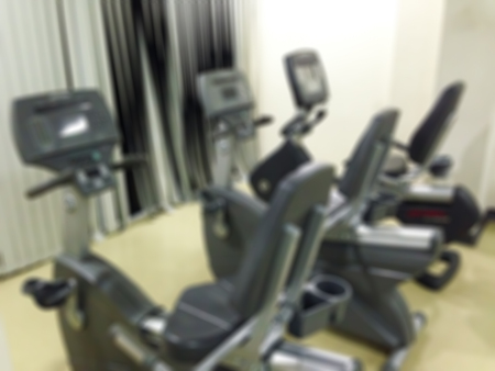 stationary bike: Blur stationary bike in the fitness room Stock Photo