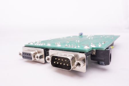 pcb: Serial port and green PCB circuit with white background