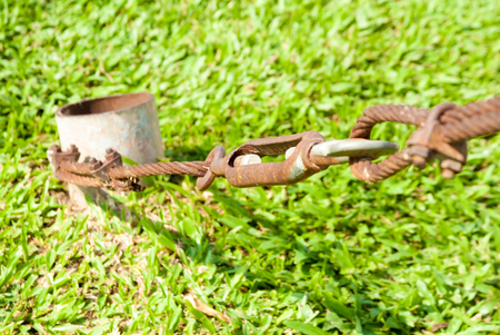shackle: The old shackle and wire sling rusty and grass background Stock Photo