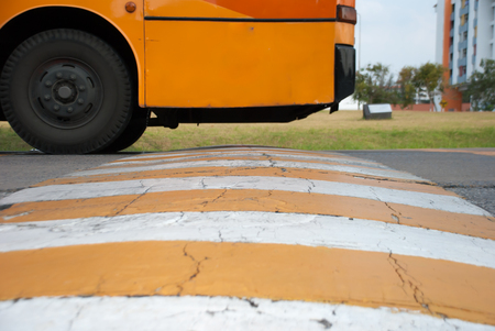 slow lane: The speed bumps on the road and the bus Stock Photo