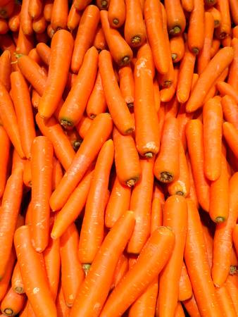 carot: The fresh orange carot in the market close up