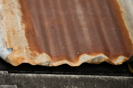 damaged roof: The damaged and rusted metal sheet of roof Stock Photo