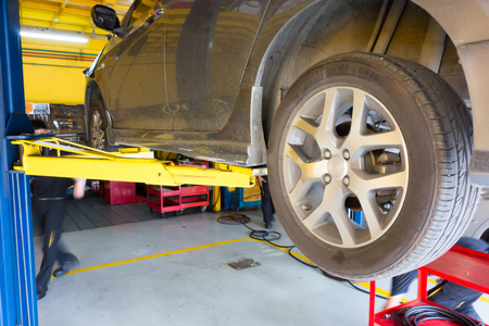 car lift: The car lift up for maintenance in the garage Stock Photo
