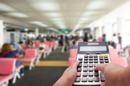 holiday budget: Travel cost calculation concept by calculator and terminal in background Stock Photo