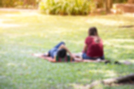chillout: Blur Asian couple relaxed by chillout in the garden for background Stock Photo