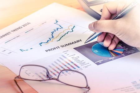 cuadro sinoptico: Financial accounting profit summary graphs analysis with hand writing
