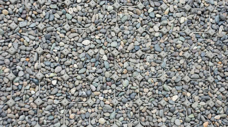 The close up Rock texture background with plastic net prevent slip 版權商用圖片