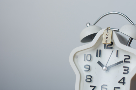 The clock close up on white background with copy space