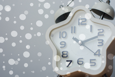 Closed up of modern white clock on background with bokeh 版權商用圖片