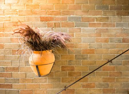 The vintage flowerpot on a Brick Wall