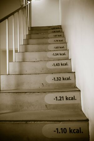 weight loss success: The weight loss success concept by stair with calorie tag