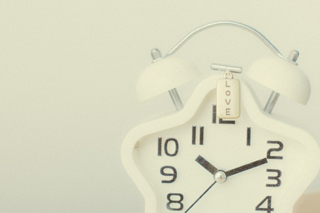 Closed up of white modern clock on the background Stockfoto