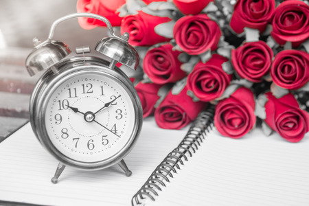 The alarm clock and red roses in garden,digital effect abstract for background 版權商用圖片