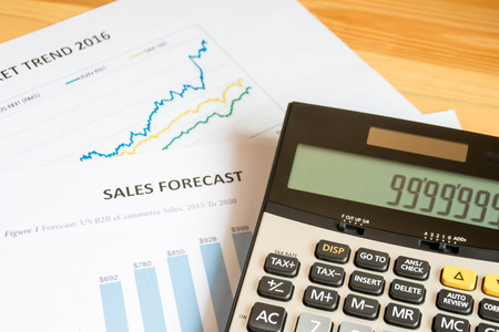 Finance information on business charts and tables, shallow dof