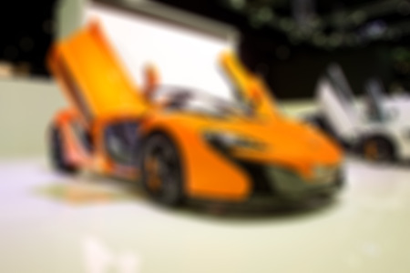 Blur of modern car in the showroom for background