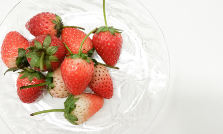 The closed up Bowl of strawberries top view