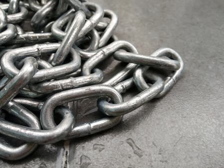 Close up of metal chain on the floor