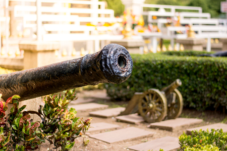 The big old cannon with small cannon in background and sunlight