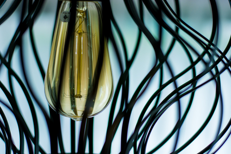 The close up of lightbulb with Hanging lamp