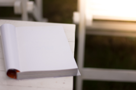 Close up the white book on the table in garden with sun light Stockfoto