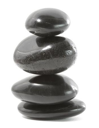 Pierres de massage noires empilées, isolées. Banque d'images