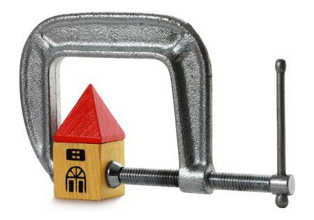 vice grip: Mortgage pressure Stock Photo