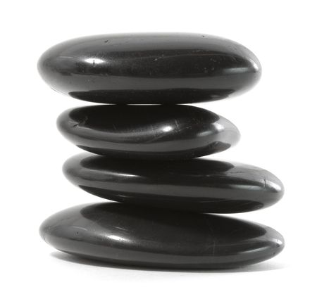 river stones: Black massage stones stacked, isolated.