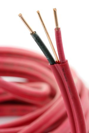 insulated: Macro of an insulated cable, with focus on the copper strands. Stock Photo