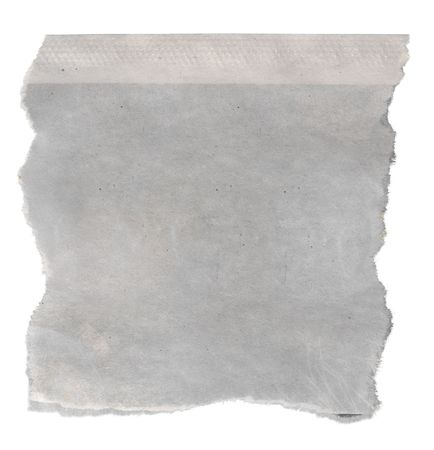 Macro of a blank torn newspaper, isolated on white background.