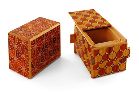 Two wooden japanese puzzle boxes, isolated on a white background, one opened and one closed