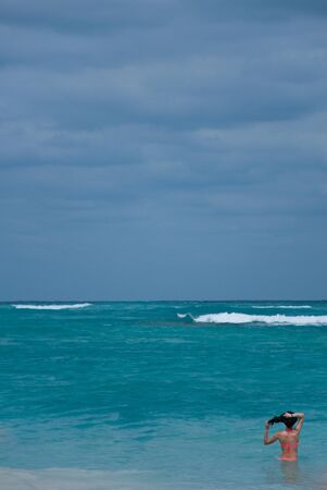 caribbeans: Woman Looking at the Ocean Stock Photo