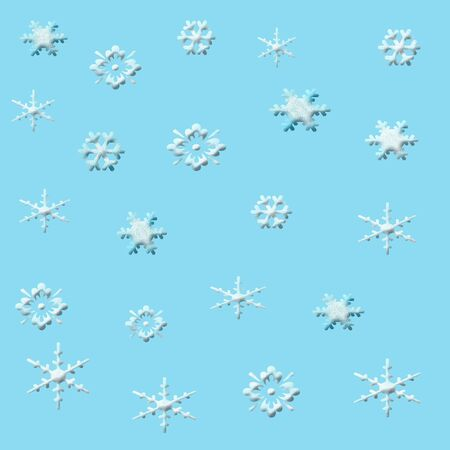 delicate assorted textured snowflakes on solid background Stok Fotoğraf