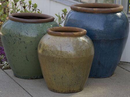 ceramic clay pots  three colorful jugs closeup Stock Photo