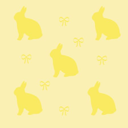 Easter bunnies and bows on solid background photo
