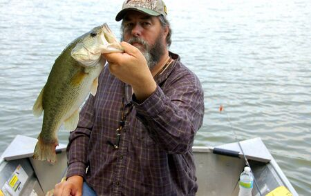 big mouth: fisherman holding a large mouth bass closeup Stock Photo