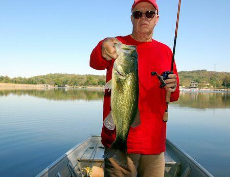 fisherman holding a large mouth bass closeup Reklamní fotografie