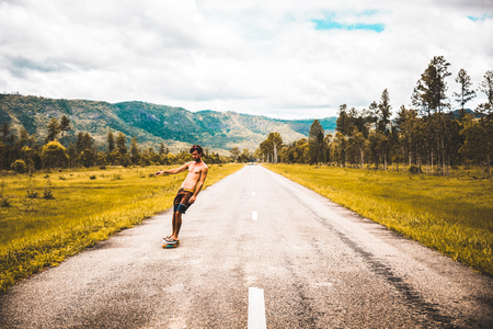 Man skating on road during daytime