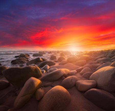 brown rocks beside beach during sunrise